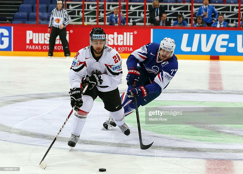 Sacha Treille (R) of France and Martin Schumnig (L) of Austria battle for the puck during the IIHF World Championship group H match between France and Austria at Hartwall Areena on May 5, 2013 in Helsinki, Finland.