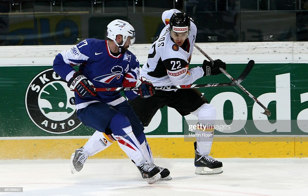 Sacha Treille of France fights for the puck with Michael Bakos of Germany during the IIHF World Ice Hockey Championship preliminary round group B...