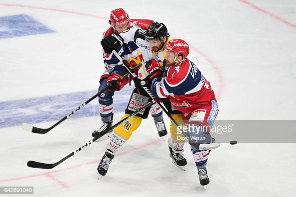 Sacha Treille of Rouen tries to slip between Christophe Tartari of Grenoble and Teddy Trabichet of Grenoble during the French Cup Final match between...