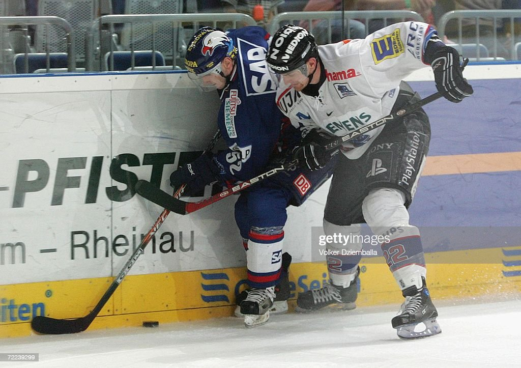 Sachar Blank left of Mannheim fights for the puck against Michael Bakos during the DEL Bundesliga game between Adler Mannheim and ERC Ingolstadt at...