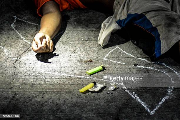 Sachets of crystal meth known locally as quotshabuquot is seen next to the corpse of a suspected drug pusher on a street after he was shot dead...