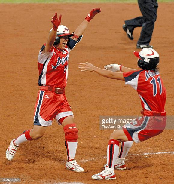 Sachiko Ito of Japan celebrates hitting the gamewinning single with her team mate Eri yamada after the Softball Women's World Championship Group B...