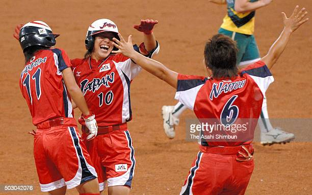 Sachiko Ito of Japan celebrates hitting the gamewinning single with her team mates Eri Yamada and Emi Naito after the Softball Women's World...