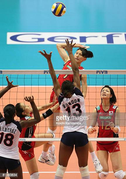 Sachiko Sugiyama of Japan spikes the ball against Cindy Rondon Martinez and Bethania De La Cruz de Pena of the Dominican Republic during FIVB Women's...