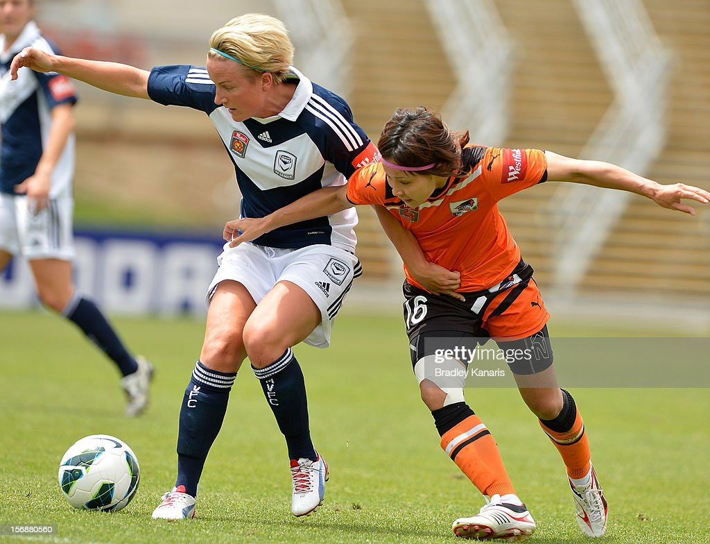 Sachiko Tatsuoka of the Roar and Petra Larsson of the Victory challenge for the ball during the round six W-League match between the Brisbane Roar and the Melbourne Victory at the Queensland Sport and Athletics Centre on November 24, 2012 in Brisbane, Australia.
