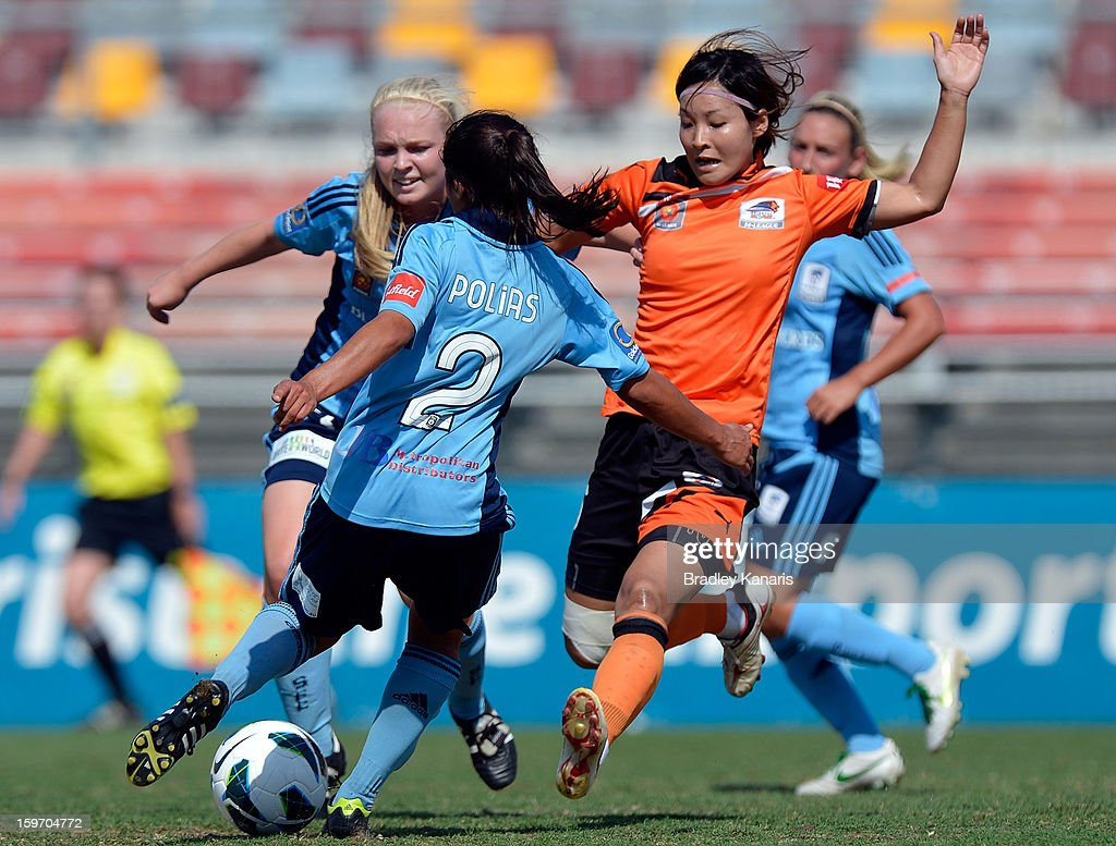 Sachiko Tatsuoka of the Roar and Teresa Polias of Sydney compete for the ball during the W-League Semi Final match between the Brisbane Roar and Sydney FC at Queensland Sport and Athletics Centre on January 19, 2013 in Brisbane, Australia.