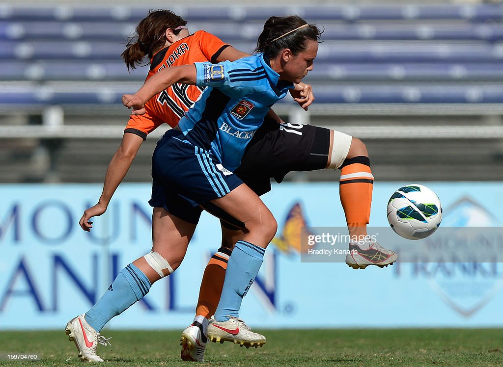 Sachiko Tatsuoka of the Roar is challenged by the Sydney defence during the W-League Semi Final match between the Brisbane Roar and Sydney FC at Queensland Sport and Athletics Centre on January 19, 2013 in Brisbane, Australia.