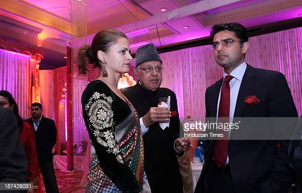 Sachin Pilot with his wife Sarah Pilot and Indian politician Farooq Abdullah attending the marriage reception of YES Bank founder Rana Kapoor's...