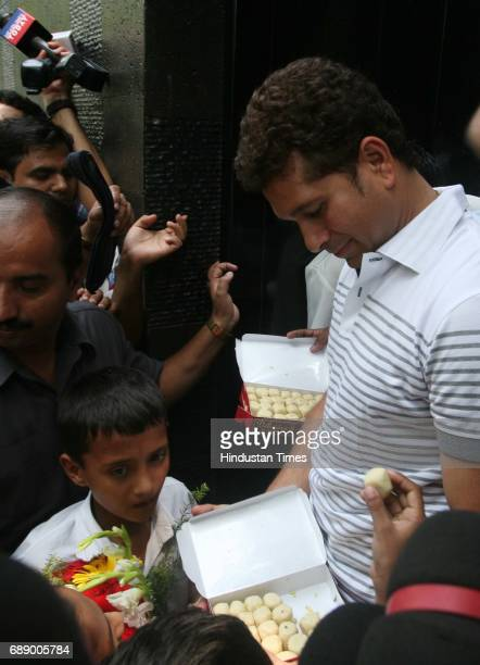Sachin Tendulakr enjoys the sweets with the children after shifting to his new house on Perry Cross Road Bandra