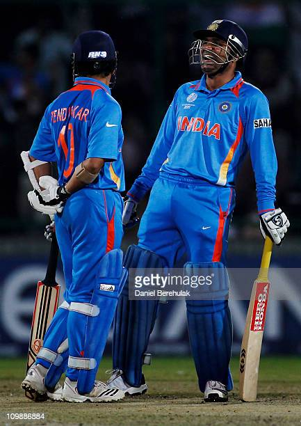 Sachin Tendulkar and Virender Sehwag of India talk in between deliveries during the 2011 ICC Cricket World Cup Group B match between India and the...