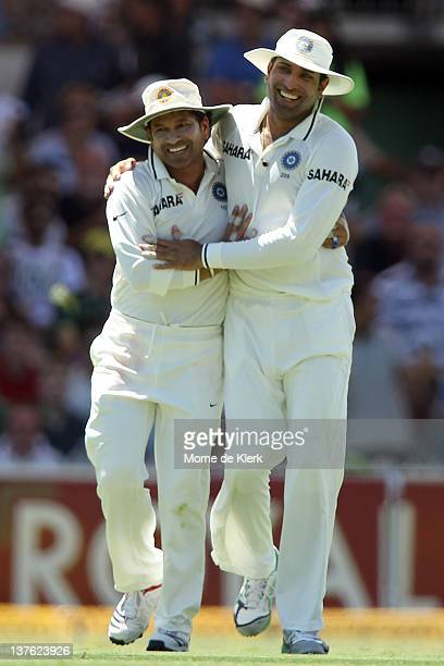 Sachin Tendulkar and VVS Laxman of India celebrate after Laxman took a catch to dismiss Ed Cowan of Australia during day one of the Fourth Test Match...