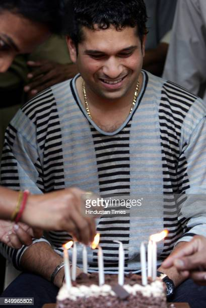 Sachin Tendulkar cutting cake on his 33rd birthday at his residence