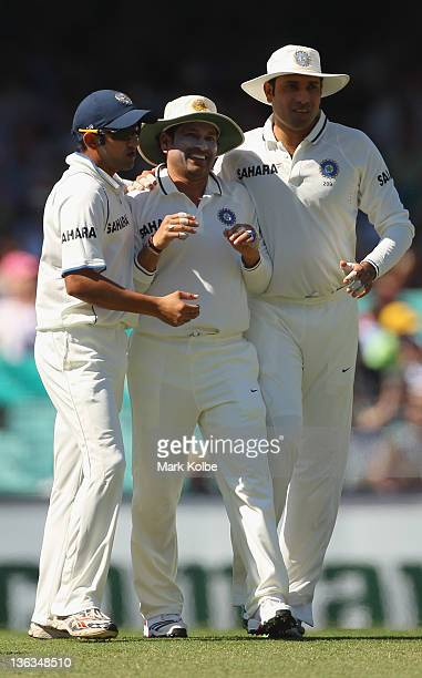 Sachin Tendulkar Gautam Gambhir and VVS Laxman of India celebrate the wicket of David Warner of Australia during day one of the Second Test Match...