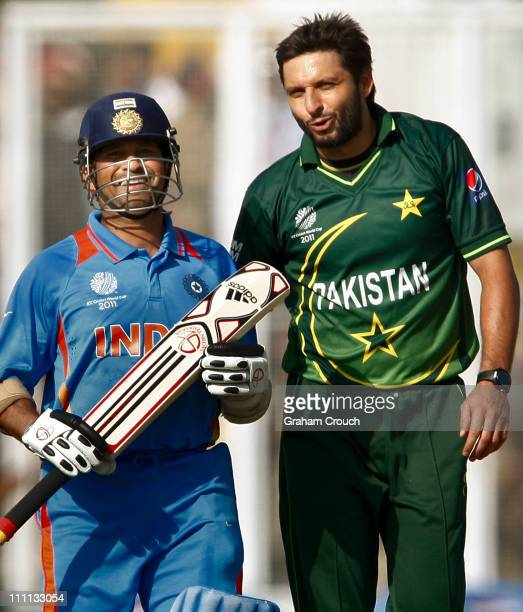 Sachin Tendulkar of India and Shahid Afridi of Pakistan exchange words after Tendulkar was dropped by Younis Khan off Afridi's bowling during the...