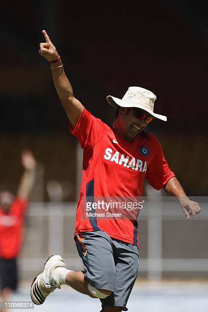 Sachin Tendulkar of India celebrates a goal during the India nets session at the Sardar Patel Gujarat Stadium on March 22 2011 in Ahmedabad India