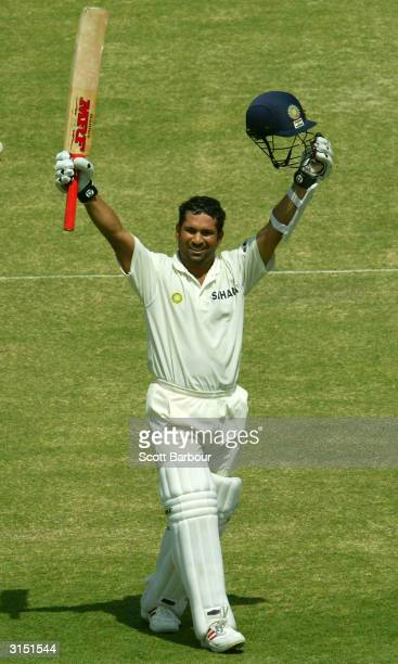 Sachin Tendulkar of India celebrates after reaching his century during day 2 of the 1st Test Match between Pakistan and India at Multan Stadium on...