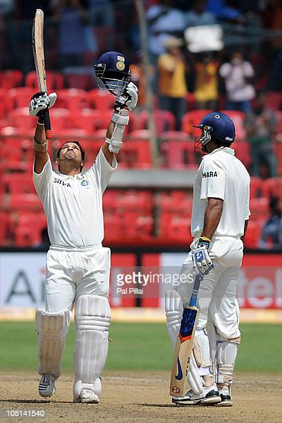 Sachin Tendulkar of India celebrates after scoring a century during day three of the Second Test match between India and Australia at MChinnaswamy...