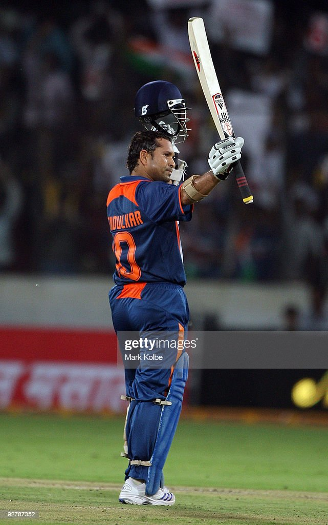 Sachin Tendulkar of India celebrates after scoring his century during the fifth One Day International match between India and Australia at Rajiv Gandhi International Cricket Stadium on November 5, 2009 in Hyderabad, India.