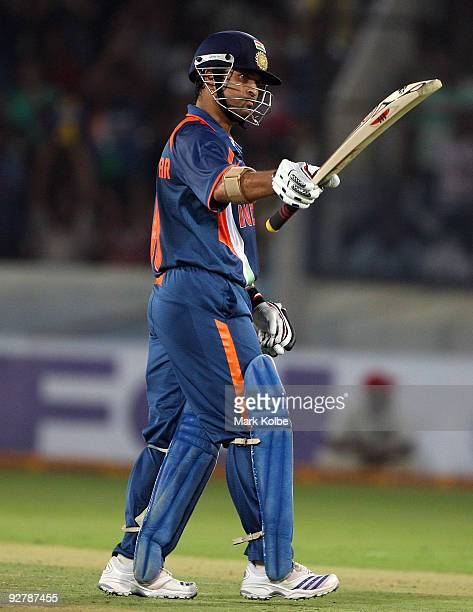 Sachin Tendulkar of India celebrates after scoring his halfcentury during the fifth One Day International match between India and Australia at Rajiv...
