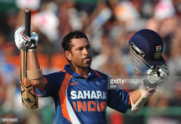 Sachin Tendulkar of India celebrates his 100 during the 2nd ODI between India and South Africa at Captain Roop Singh Stadium on February 24 2010 in...