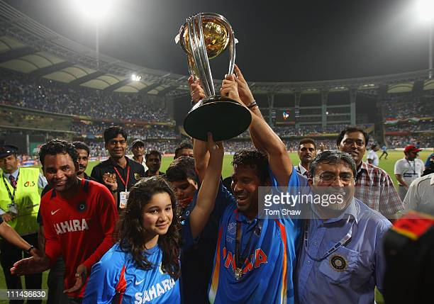 Sachin Tendulkar of India celebrates his children Sara and Arjun after India won the world cup during the 2011 ICC World Cup Final between India and...