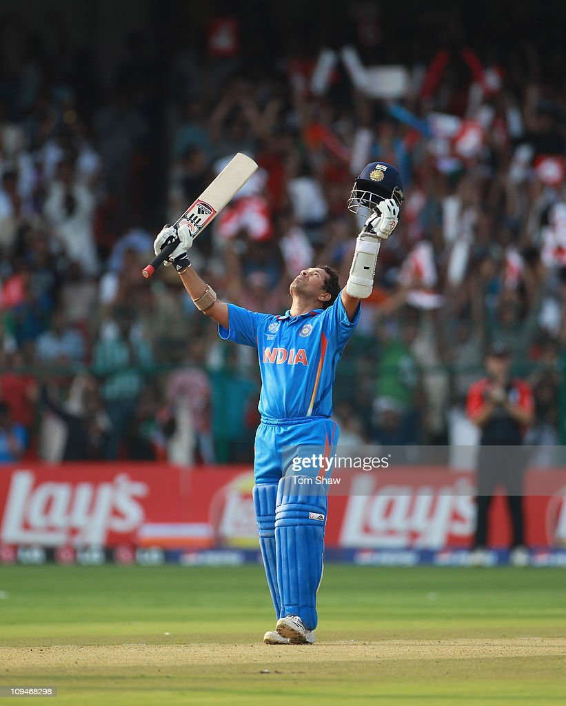<a gi-track='captionPersonalityLinkClicked' href=/galleries/search?phrase=Sachin+Tendulkar&family=editorial&specificpeople=201846 ng-click='$event.stopPropagation()'>Sachin Tendulkar</a> of India celebrates reaching his century during the 2011 ICC World Cup Group B match between India and England at M. Chinnaswamy Stadium on February 27, 2011 in Bangalore, India.