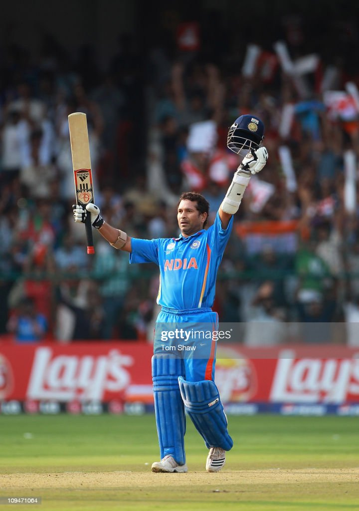 Sachin Tendulkar of India celebrates reaching his century during the 2011 ICC World Cup Group B match between India and England at M. Chinnaswamy Stadium on February 27, 2011 in Bangalore, India.