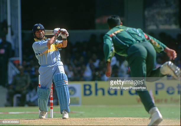 Sachin Tendulkar of India drives a delivery from Pakistan bowler Waqar Younis during the Wills World Cup Quarter Final between India and Pakistan at...