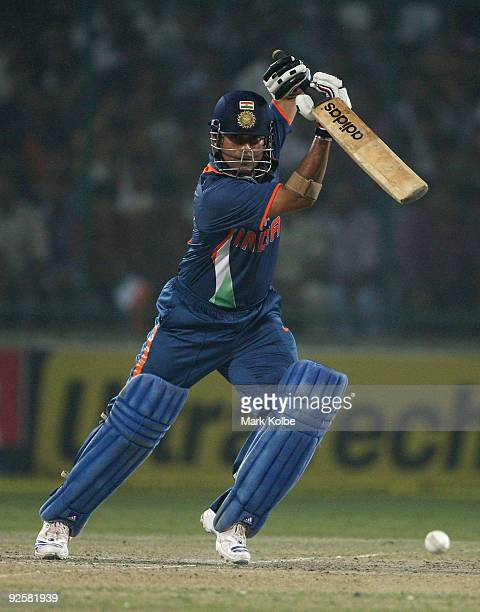 Sachin Tendulkar of India drives through the offside during the third One Day International match between India and Australia at Feroz Shah Kotla on...