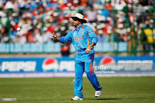 Sachin Tendulkar of India fields during the 2011 ICC Cricket World Cup Group B match between India and the Netherlands at Feroz Shah Kotla stadium on...