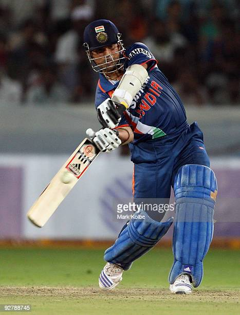 Sachin Tendulkar of India hits out during the fifth One Day International match between India and Australia at Rajiv Gandhi International Cricket...