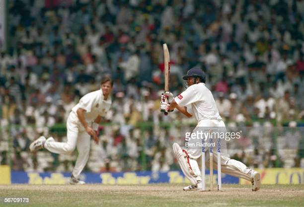 Sachin Tendulkar of India hits out on his way to 155 runs during the BorderGavaskar Trophy 1997/98 1st Test Match between India and Australia held on...