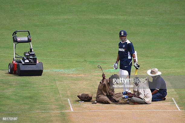 Sachin Tendulkar of India inspects the match pitch after the Indian cricket team training session at the MChinnaswamy Stadium on October 82008 in...