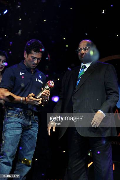 Sachin Tendulkar of India is present with the ICC cricketer of the year award by ICC presdient Sharad Pawar during the ICC Annual Awards at the Grand...