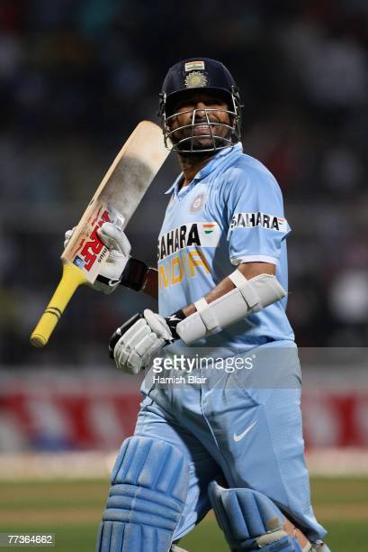 Sachin Tendulkar of India leaves the field after being dismissed during the seventh one day international match between India and Australia at...