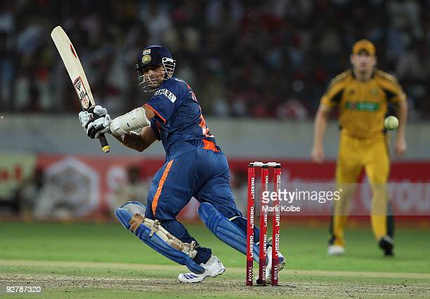 Sachin Tendulkar of India plays the ball behind square during the fifth One Day International match between India and Australia at Rajiv Gandhi...