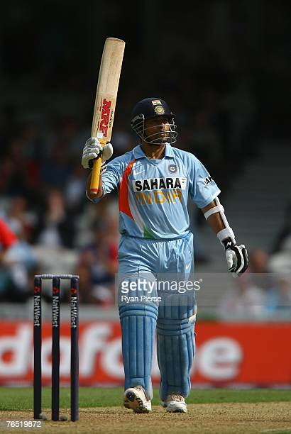 Sachin Tendulkar of India raises his bat after reaching 50 runs during the 6th NatWest One Day International match between England and India at The...