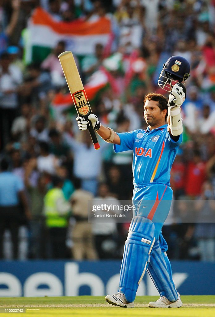 Sachin Tendulkar of India raises his bat on scoring his century during the Group B ICC World Cup Cricket match between India and South Africa at Vidarbha Cricket Association Ground on March 12, 2011 in Nagpur, India.
