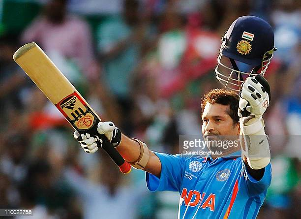 Sachin Tendulkar of India raises his bat on scoring his century during the Group B ICC World Cup Cricket match between India and South Africa at...