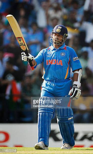 Sachin Tendulkar of India raises his bat on scoring his half century during the Group B ICC World Cup Cricket match between India and South Africa at...