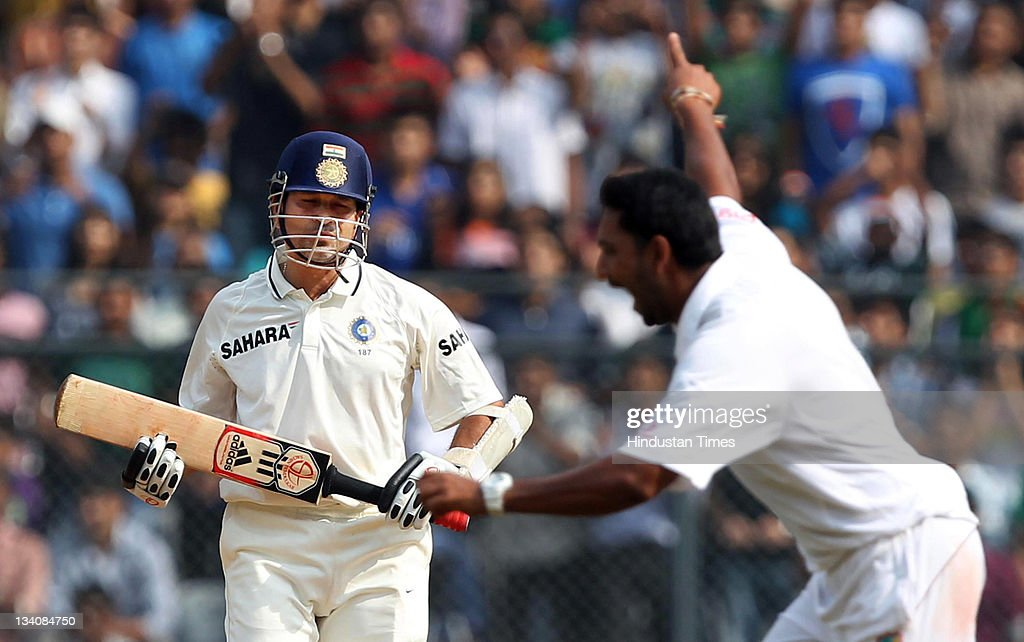 Sachin Tendulkar of India reacts as he got out for 94 runs by West Indies bowler Ravi Rampaul during the fourth day of the third test match between India and West Indies at Wankhede stadium on November 25, 2011 in Mumbai, India. (Photo by Santosh Harhare/Hindustan Times via Getty Images).