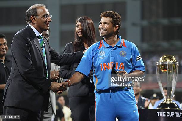Sachin Tendulkar of India receives his winners medal from Haroon Lorgat Chief Executive of ICC during the 2011 ICC World Cup Final between India and...
