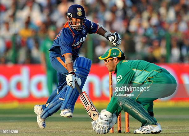 Sachin Tendulkar of India scrapes in to the crease on his way to a record double century during the 2nd ODI between India and South Africa at Captain...