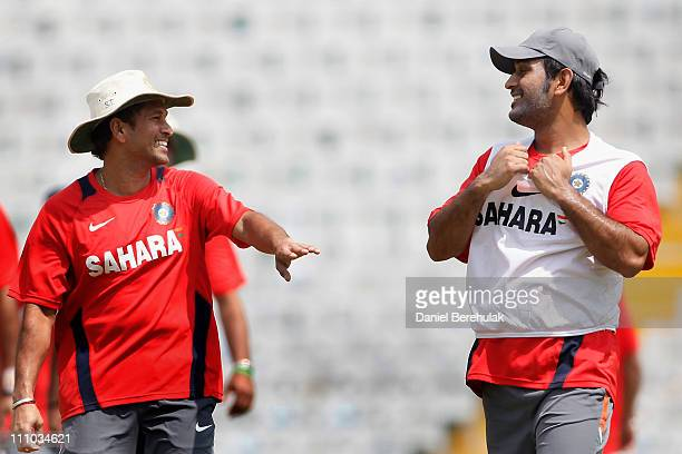 Sachin Tendulkar of India speaks with captain Mahendra Singh Dhoni of India during an Indian training session on March 29 2011 in Mohali India India...