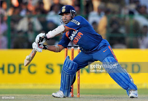 Sachin Tendulkar of India square cuts on his way to a record double century during the 2nd ODI between India and South Africa at Captain Roop Singh...