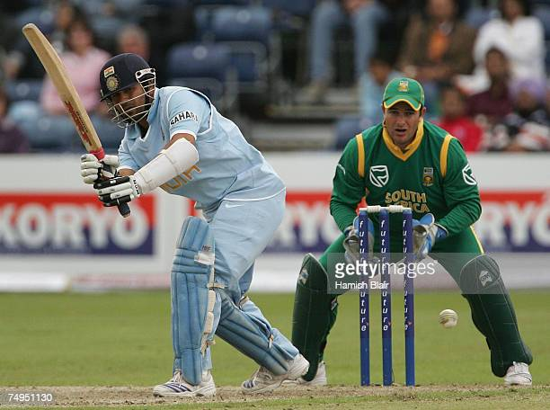 Sachin Tendulkar of India turns the ball to mid wicket with Mark Boucher of South Africa looking on during the second One Day International match...