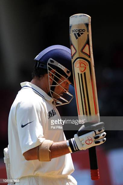 Sachin Tendulkar of India walks back after getting out during day four of the Second Test match between India and Australia at MChinnaswamy Stadium...