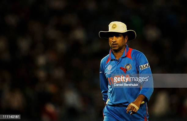 Sachin Tendulkar of India walks back to field during the 2011 ICC World Cup second SemiFinal between India and Pakistan at Punjab Cricket Association...