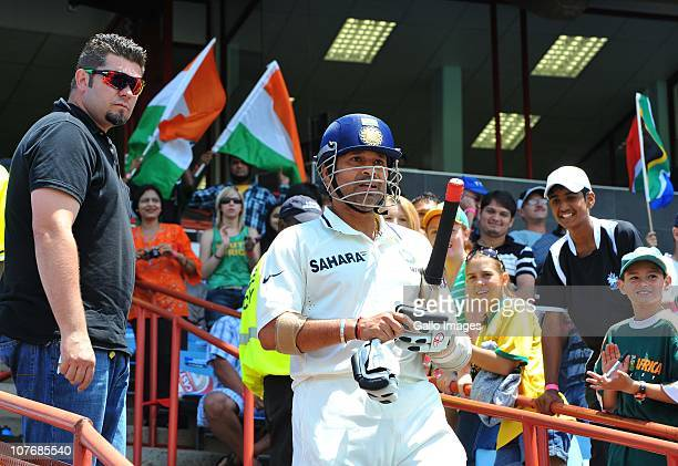 Sachin Tendulkar of India walks off after his unbeaten 50th Test century during day 4 of the 1st Test match between South Africa and India at...