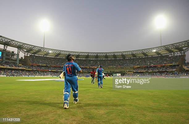 Sachin Tendulkar of India walks out to bat during the 2011 ICC World Cup Final between India and Sri Lanka at the Wankhede Stadium on April 2 2011 in...